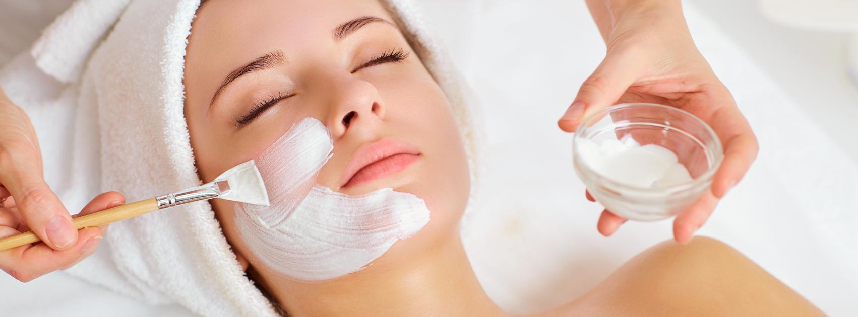 women receiving facial treatment