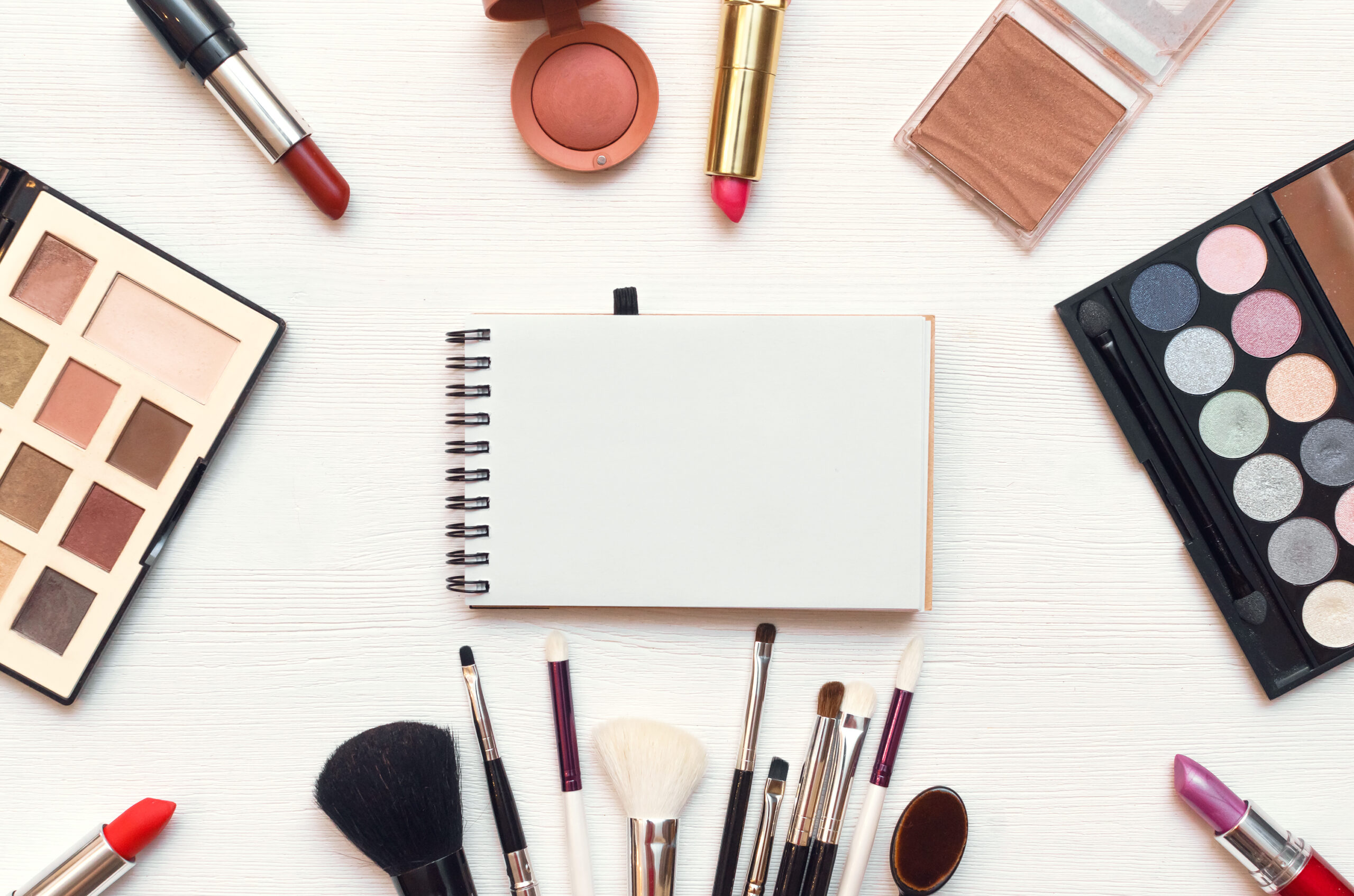makeup, brushes, and notepad