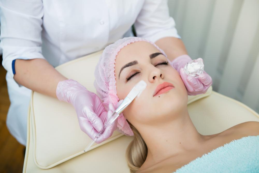 woman receiving a facial treatment at a spa